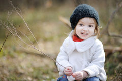 Adorable girl on early spring or autumn Stock Photos