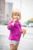 Adorable girl eat ice cream on bus stop Royalty Free Stock Photo