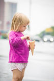 Adorable girl eat ice cream on bus stop Stock Photography