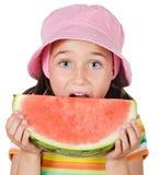 Adorable girl eating stock image