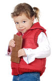 Adorable girl eating chocolate. A over white background Stock Images
