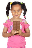 Adorable girl eating chocolate Stock Photography