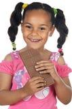 Adorable girl eating chocolate Stock Photo