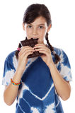 Adorable girl eating chocolate Stock Photography