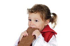 Adorable girl eating chocolate Royalty Free Stock Photography