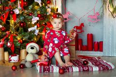 Adorable girl eating gingerbread cake In house during Christmas holiday season royalty free stock photos