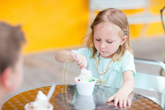 Adorable girl eating ice cream Royalty Free Stock Images