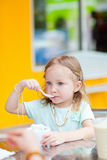 Adorable girl eating ice cream Stock Photography