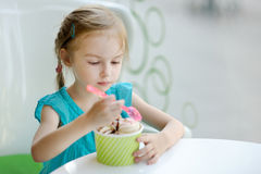 Adorable girl eating ice cream Stock Photos