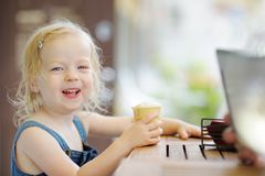 Adorable girl eating ice cream Royalty Free Stock Photos