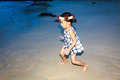 Adorable Girl. Enjoys play time on the beach stock photography