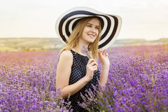 Adorable girl in fairy field of lavender Royalty Free Stock Images