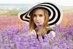 Adorable girl in fairy field of lavender. Portrait of carefree adorable girl in fairy field of lavender. Summer freedom enjoy concept stock photo