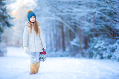 Adorable girl with flashlight and candle in winter on Xmas eve outdoors Stock Image