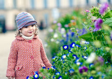Adorable girl with flowers. An adorable girl smells flowers Stock Images