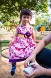 Adorable girl fun in the park. Sunlight in the kids playground. Royalty Free Stock Image