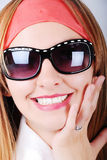Adorable girl with glasses. An adorable girl with glasses and red strip on head Stock Photo