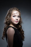 Adorable girl with gold decoration on her head Royalty Free Stock Photography