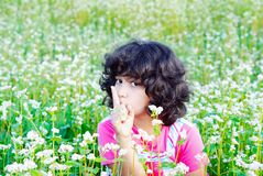 Adorable girl on grass Stock Images