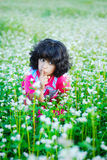 Adorable girl on green grass. In nature Royalty Free Stock Images