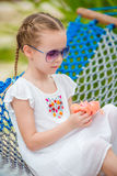Adorable girl in hammock outdoor at tropical vacation Royalty Free Stock Photo