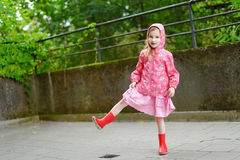 Adorable girl happily standing under the rain Royalty Free Stock Photography