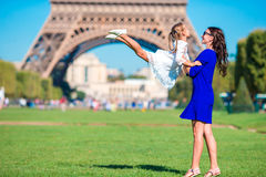 Adorable girl and happy mother in Paris background Eiffel Tower Royalty Free Stock Photo