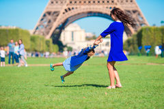 Adorable girl and happy mother in Paris background Eiffel Tower Royalty Free Stock Photos