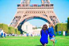 Adorable girl and happy mother in Paris background Eiffel Tower Stock Images