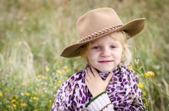 Adorable girl with hat in autumn  meadow Stock Photos