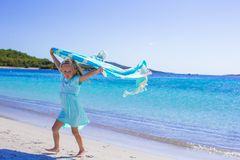Adorable girl have fun with beach towel during Royalty Free Stock Photography