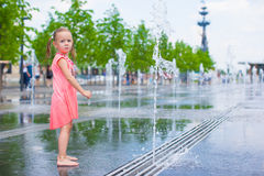 Adorable girl have fun at hot sunny summer day Royalty Free Stock Photo