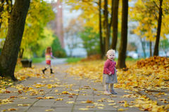 Adorable girl having fun on beautiful autumn day Royalty Free Stock Photography