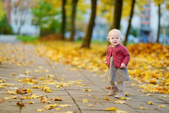 Adorable girl having fun on beautiful autumn day Royalty Free Stock Photos