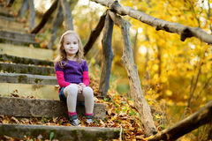 Adorable girl having fun in beautiful autumn park Royalty Free Stock Image