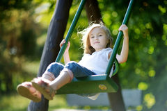 Adorable girl having fun on a swing Royalty Free Stock Images