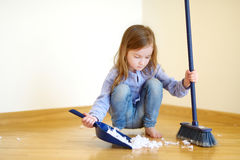 Adorable girl helping her mom to clean up Royalty Free Stock Images