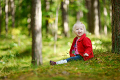 Adorable girl hiking in the forest on autumn day Stock Images