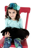 Adorable girl holding a black lab puppy Royalty Free Stock Photo
