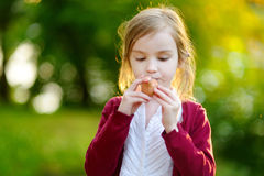 Adorable girl holding clay whistle Royalty Free Stock Photo