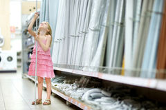 Adorable girl in a houseware store Stock Images