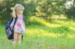 Adorable girl with huge backpack walking in park Stock Photography