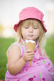 Adorable Girl In Pink Hat Eat Ice Cream Royalty Free Stock Photography