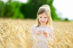Free Adorable Girl In Wheat Field On Warm Summer Day Stock Photography - 43946692