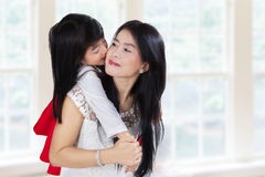 Adorable girl kissing her mother Royalty Free Stock Photography