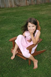 Adorable Girl Laughing. Little girl sitting in lawn chair laughing Stock Photos