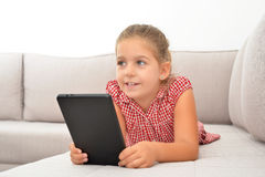 Adorable girl learning with her tablet device Royalty Free Stock Photo