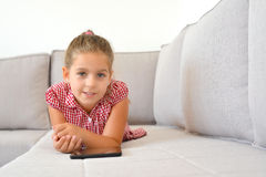 Adorable girl learning with her tablet device Royalty Free Stock Photos