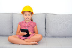 Adorable girl learning with her tablet device Stock Image