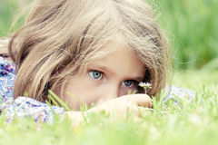 Adorable girl lying on grass Stock Images